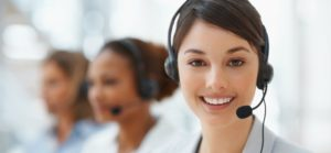 call-center1-300x139 Closeup of a cute business woman with headset at workplace